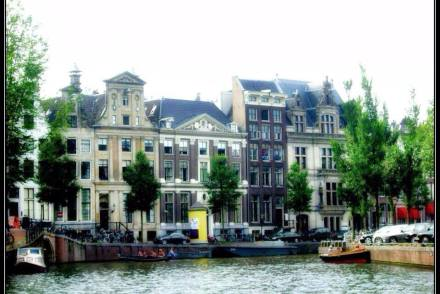 Unique architecture of the houses along Amsterdam Canal during an Amsterdam Canal Cruise.